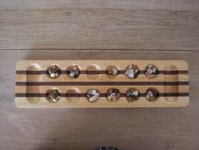 Kalaha - Spiel mit glassteinchen vorbereitet 4